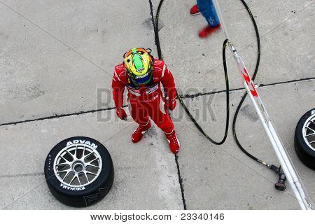 SEPANG - JUNE 19: LMP Motorsports' driver waits for his car to come in for driver change, refueling and tire change during the Japan SUPER GT Round 3 race on June 19, 2011 in Sepang, Malaysia.
