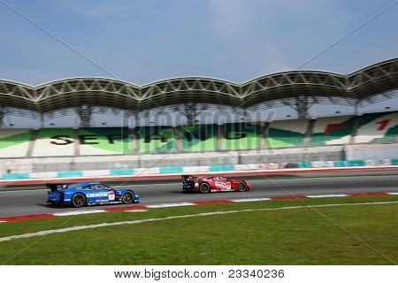 SEPANG, MALAYSIA - JUNE 19: NISMO's Nissan GT-R R35 (#23) leads the Team Impul's car during practice in the Sepang International Circuit at the Japan SUPER GT Round 3 race on June 19, 2011 in Sepang, Malaysia.