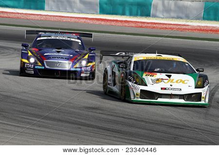 SEPANG - JUNE 19: The Lamborghini Gallardo (86) of the JLOC accelerates into turn 2 of the Sepang International Circuit tracks in the Japan SUPER GT Round 3 race on June 19, 2011 in Sepang, Malaysia.