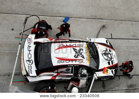 SEPANG, MALAYSIA - JUNE 19: Team SG Changi car pits for refuel, and driver and tire change at the Sepang International Circuit in the Japan SUPER GT Round 3 race on June 19, 2011 in Sepang, Malaysia.