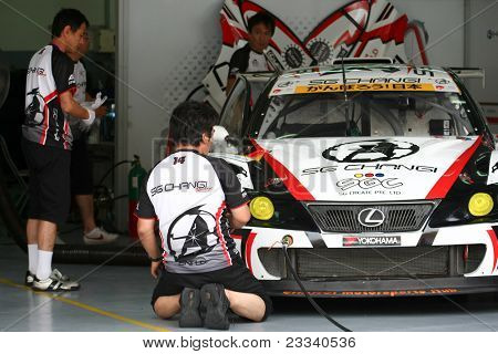 SEPANG - JUNE 18:The Lexus IS350 car of Team SG Changi gets prepared for the practice runs at the Sepang International Circuit in the Japan SUPER GT Round 3 race on June 18, 2011 in Sepang, Malaysia.