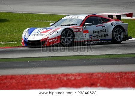 SEPANG, MALAYSIA - JUNE 18: The race car of Weider Honda Racing team puts in some practice laps in the Sepang International Circuit at the Japan SUPER GT Round 3 on June 18, 2011 in Sepang, Malaysia.