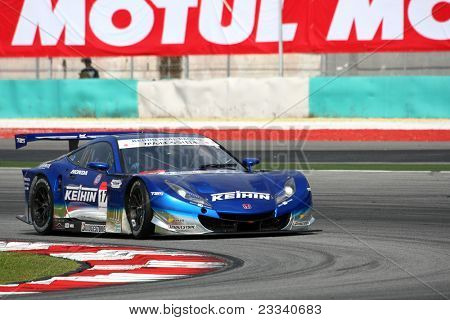 SEPANG - JUNE 18: The Honda HSV-010 car of Keihin Real Racing puts in some practice laps in the Sepang International Circuit during the Japan SUPER GT Round 3 on June 18, 2011 in Sepang, Malaysia.