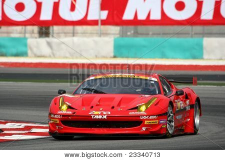 SEPANG, MALAYSIA - JUNE 18: The Ferrari 458 car of Jimgainer puts in some practice laps in the Sepang International Circuit during the Japan SUPER GT Round 3 on June 18, 2011 in Sepang, Malaysia.