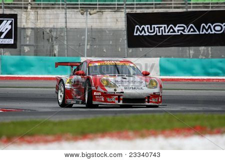 SEPANG, MALAYSIA - JUNE 18: The Porsche car of Team Taisan Cinecitta puts in some practice laps in the Sepang International Circuit at the Japan SUPER GT Round 3 on June 18, 2011 in Sepang, Malaysia.