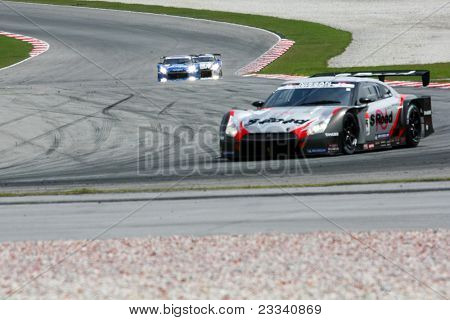 SEPANG, MALAYSIA - JUNE 18: The Nissan GTR car of Mola team puts in some practice laps in the Sepang International Circuit at the Japan SUPER GT Round 3 on June 18, 2011 in Sepang, Malaysia.