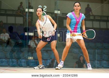 KUALA LUMPUR - JULY 20: Jenny Duncalf (blue) of England, WISPA Rank 2, watches as Low Wee Wern returns the ball at the CIMB Malaysian Open Squash 2011 on July 20, 2011 in Kuala Lumpur, Malaysia.