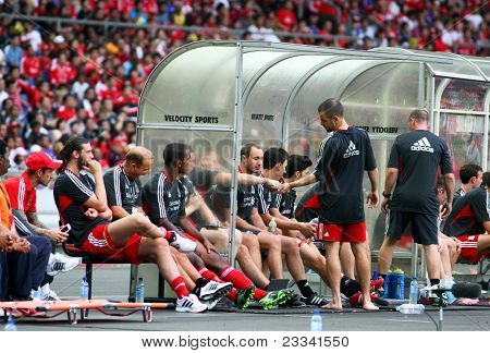 BUKIT JALIL - JULY 16: Liverpool FC's reserve players sitting on the bench during their match against Malaysia at the National Stadium on July 16, 2011, Bukit Jalil, Malaysia. Liverpool won 6-3.