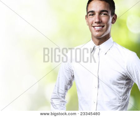 portrait of handsome young man smiling in the park