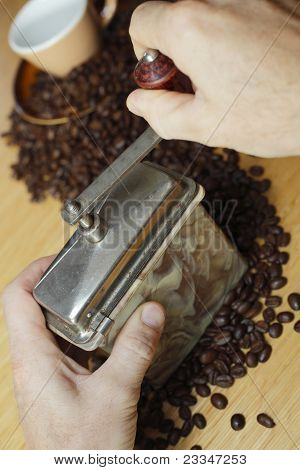 Coffee grinder with hands