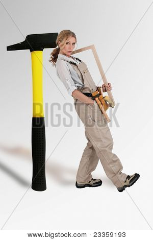 craftswoman leaning on a mega hammer