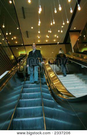 Man In Escalator