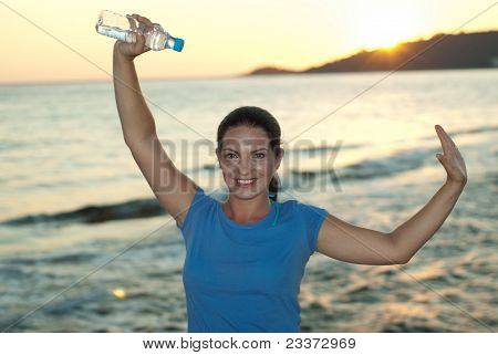 Cheerful Woman Holding Water