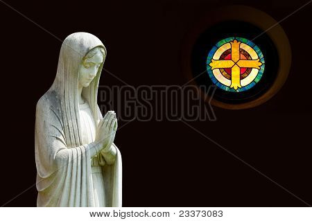 Isolated Statue Of Mary With Cross