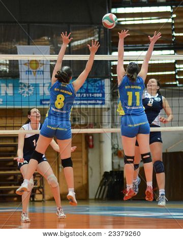 KAPOSVAR, HUNGARY - APRIL 24: Marianna Palfy (blue 11) in action at the Hungarian NB I. League woman volleyball game Kaposvar (blue) vs Ujbuda (black), April 24, 2011 in Kaposvar, Hungary.