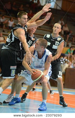 KAPOSVAR, HUNGARY - SEPTEMBER 8: Nik Raivio (white 5) in action at a friendly basketball game between Kaposvar (white) and Pecsi VSK (black) September 8, 2011 in Kaposvar, Hungary.