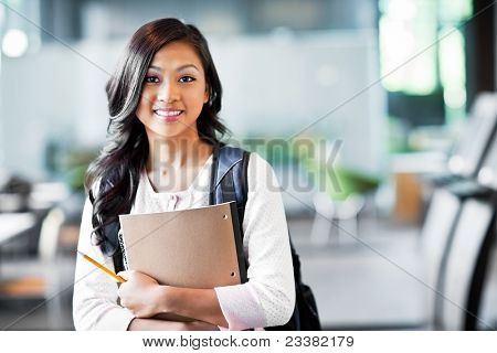 A portrait of an Asian college student on campus