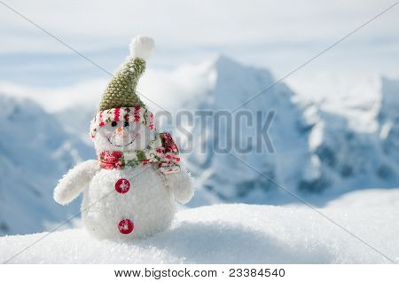 Winter Holidays - Happy snowman in mountains (space for text)