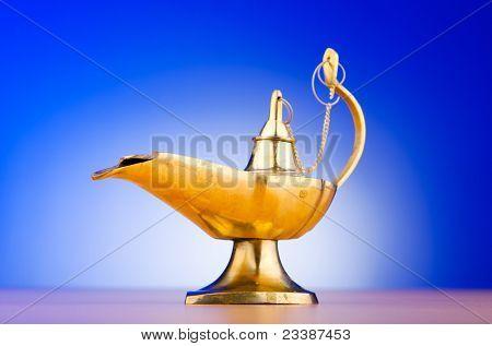Ancient lamp against gradient background