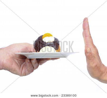 Hand Refuses Cake