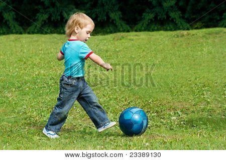 Small Boy Playing Football In The Park Outdoor. Two Years Child Running Forward.