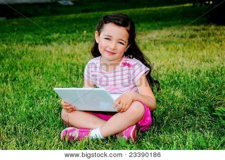 The little girl with the laptop