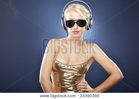 Attractive Blonde Girl With Headphones And Sunglasses