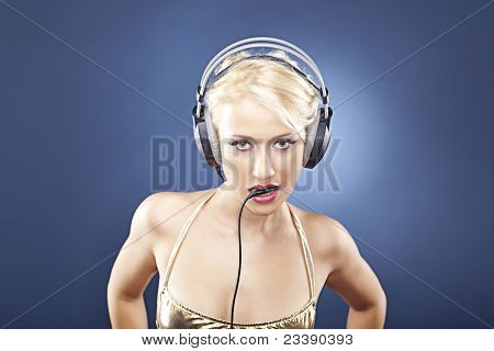 Beautiful Blonde Holding The Cable From Her Headphones In Her Mo