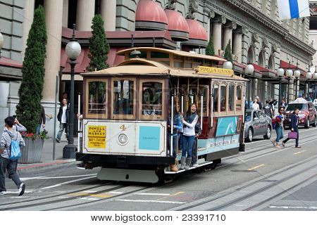 SAN FRANCISCO - AUG 20: Passengers enjoy a ride in a cable car on August 20, 2011 in San Francisco. It is the oldest mechanical public transport in San Francisco which is in service since 1873.