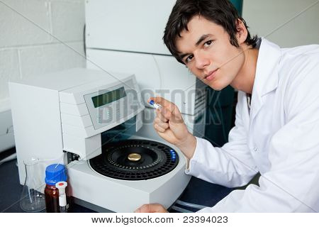 Student Posing With A Centrifuge