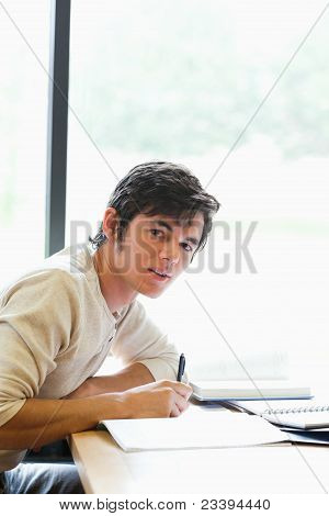 Portrait Of A Young Student Working On An Essay