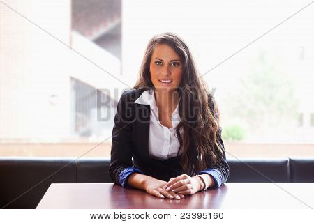 Young Woman Sitting At A Table