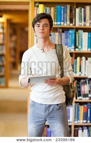 Portrait Of A Smiling Student Holding A Tablet Computer