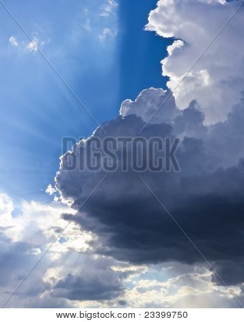 A Blue Sky Full Of Clouds And Sunbeams