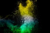 Abstract White Powder Splatter On Black Background,freeze Motion Of Color Powder Explosion. Splash O poster