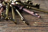 A Close Up Image Of Antique Brass And Copper House Keys. poster