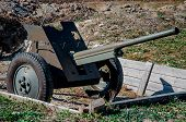 Vintage Machine Gun In A Trench. Old Soviet Machinegun On Position. Old Cannon From World War 2. Old poster