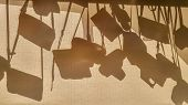An Abstract Photo Camera Cases Silhouettes On A Fabric Blind. Sun Shining Through Window, Making Mon poster