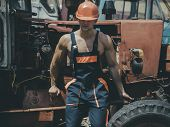 Tired Worker Concept. Muscular Builder On Sunny Day. Man, Builder Or Bodybuilder With Strict Face An poster