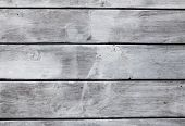 Wooden background from gray boards. Beautiful texture of the wood pattern. Great background for the  poster