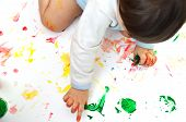 The Little Girl Is Stained With Multicolored Paints. Little Baby Paint On Hands. Painted Childrens  poster