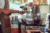 African-american Barista Making A Coffee With The Professional Coffee Machine, At The Coffee Shop. poster