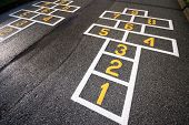 stock photo of hopscotch  - wet hopscotch marks after rain - JPG