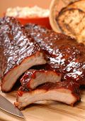 stock photo of ribs  - Delicious BBQ ribs with toasted bread cole slaw and a tangy BBQ sauce - JPG
