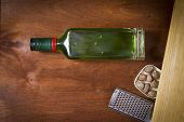 Bottle With Absinthe On A Wooden Background poster