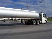 foto of big-rig  - big fuel gas tanker truck on street - JPG