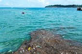 Plastic Rubbish Pollution In Ocean. Photo Showing Pollution Problem Of Garbage Thrown Directly Into  poster