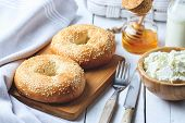 Bagel With Cottage Cheese , Banana And Honey. Concept Of Healthy Breakfast. White Wooden Background poster