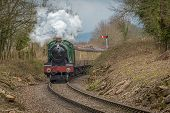 A Steam Train Appears From Around A Bend Heading Straight Towards The Camera. The Steam Locomotive I poster