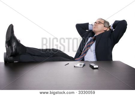 Successfull Businessman Relaxing Over His Desk